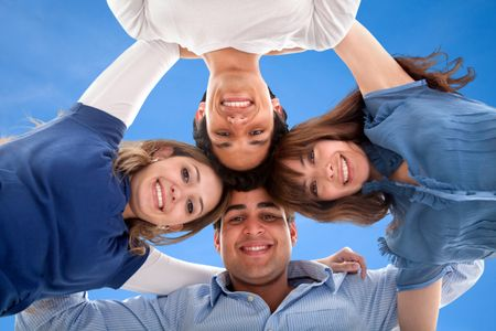 Group of people smiling with heads together isolated