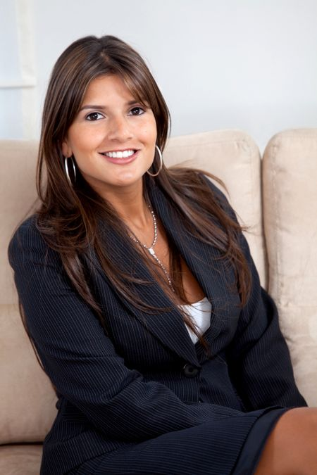 Beautiful business woman portrait smiling at an office
