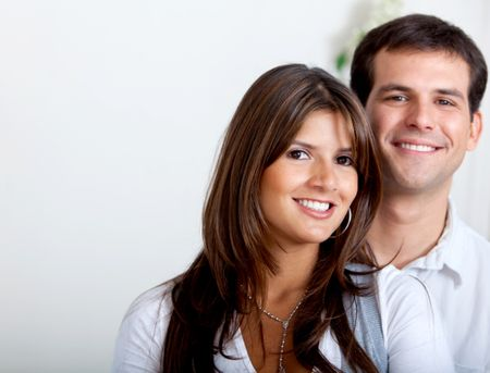 Portrait of a beautiful couple smiling indoors