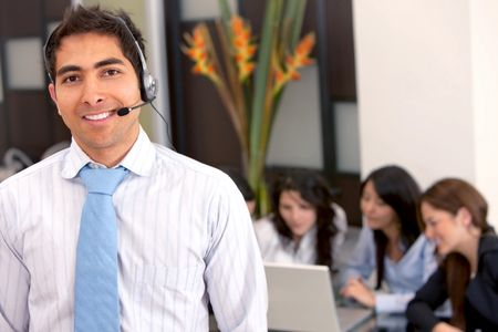 Customer support operator man smiling at an office