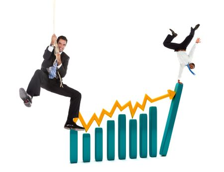 Business people over a growth graphic isolated over white