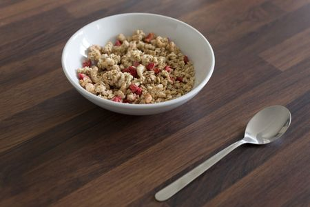 Breakfast cereal in a white bowl on a kitchen table