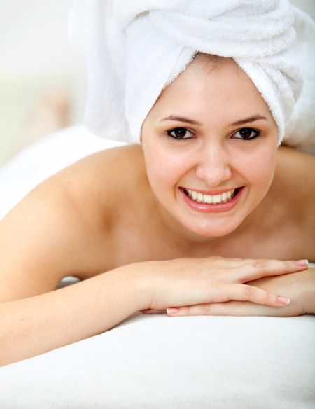 Woman portrait with a towel on her head smiling