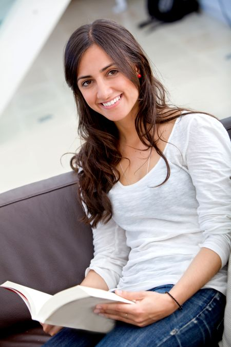Beautiful woman portrait smiling and studying at home