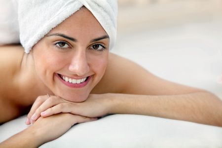 Beauty portrait of a woman with a towel on her head