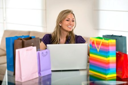beautiful woman looking for online offers at home