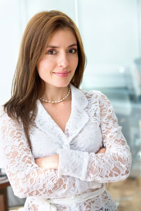 Businesswoman standing with her arms crossed in an office