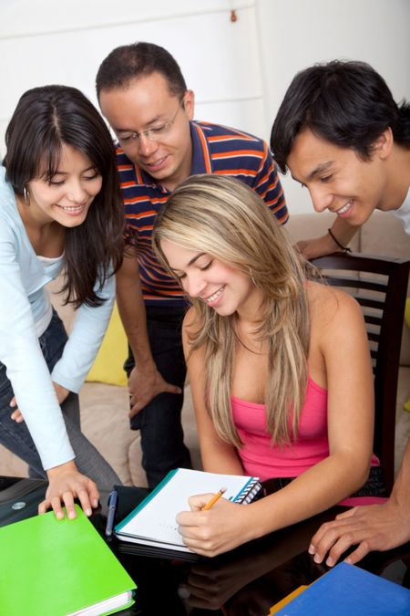 group of happy friends studying at home