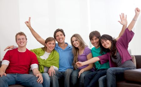 Happy group of young people sitting on a sofa
