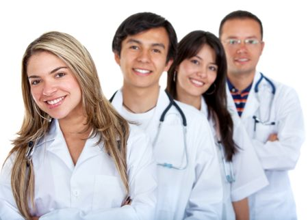 Young group of doctors smiling isolated over white