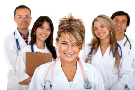 female doctor holding a stethoscope with her team behind her - isolated
