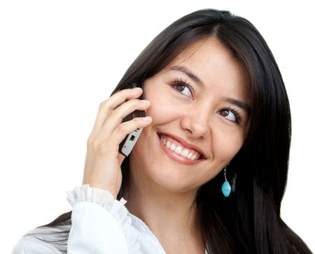business woman smiling and talking on a mobile phone - isolated over a white background