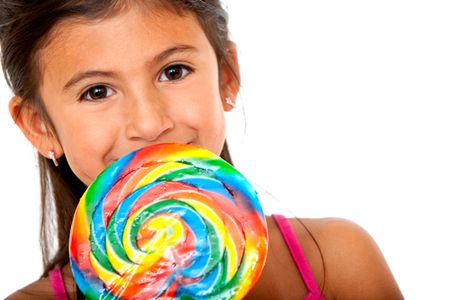 Girl eating a colorful candy isolated over a white background