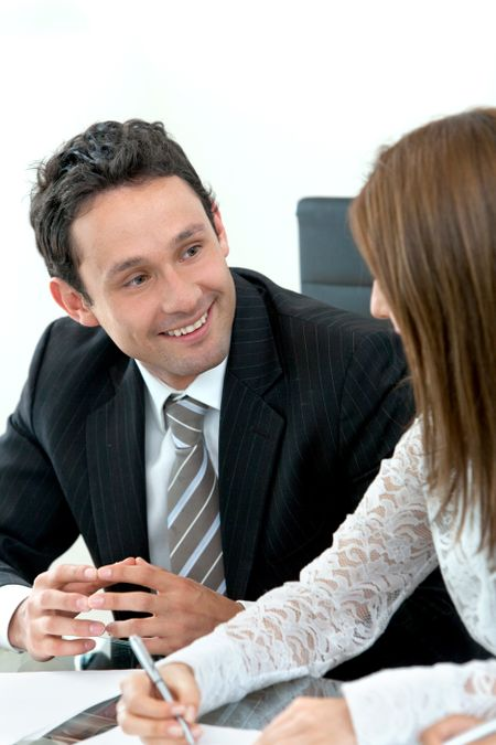 Businessman with his partner smiling in an office