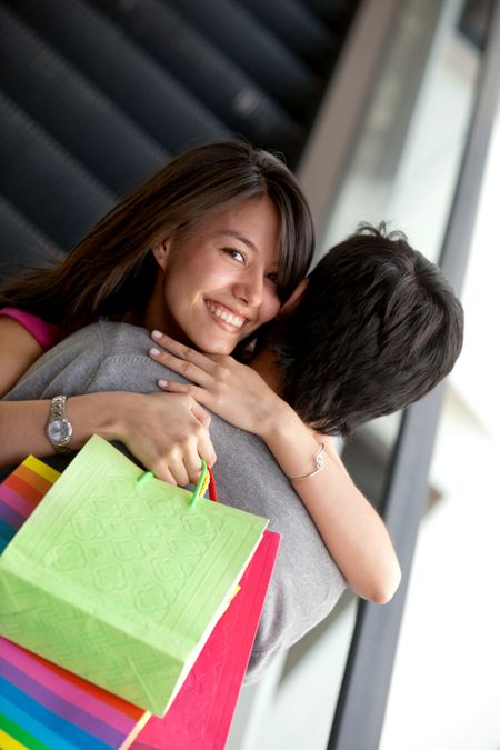 Happy couple of shoppers at a shopping mall