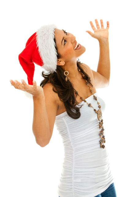 Christmas woman wearing a santa hat smiling isolated on white
