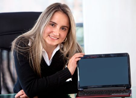 business woman displaying a laptop computer in her office