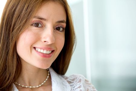 Friendly business woman portrait - smiling in her office