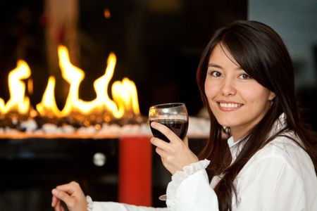Woman at a romantic dinner with a glass of wine