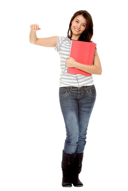 Beautiful female student leaning over an imaginary object isolated on white