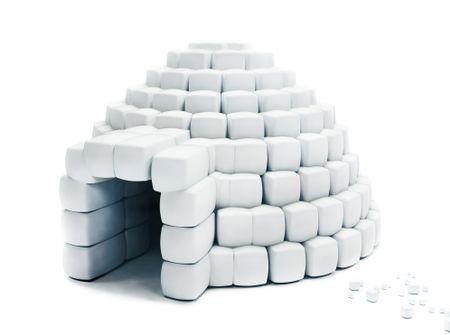 Igloo made with snow cubes isolated over a white background