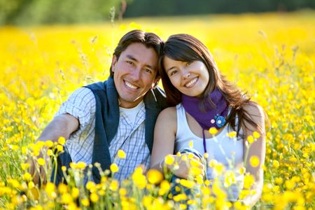 Lovely casual couple at a meadow smiling