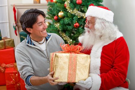Man with Santa Claus getting a Christmas gift