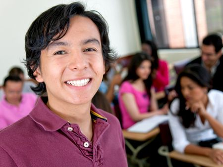 Handsome male student at the university smiling