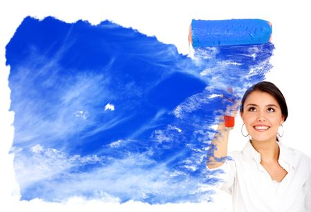 woman painting a sky with a roller isolated over a white background