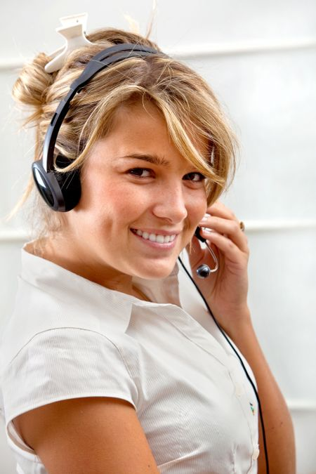 Young woman with a headset and smiling