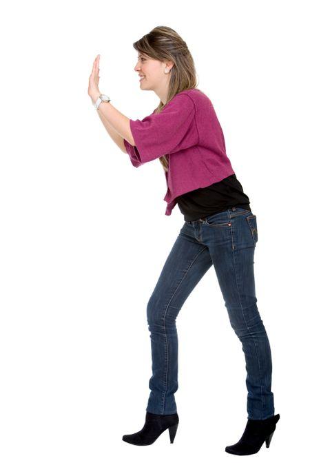 woman pushing something imaginary isolated over a white background