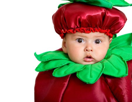 Baby boy in a fruit costume isolated over a white background