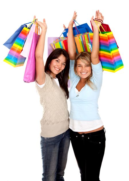 Happy shopping women isolated over a white background
