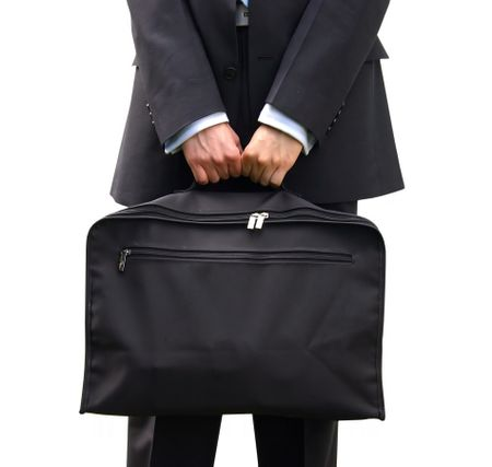 business man holding a briefcase with both hands over a white background