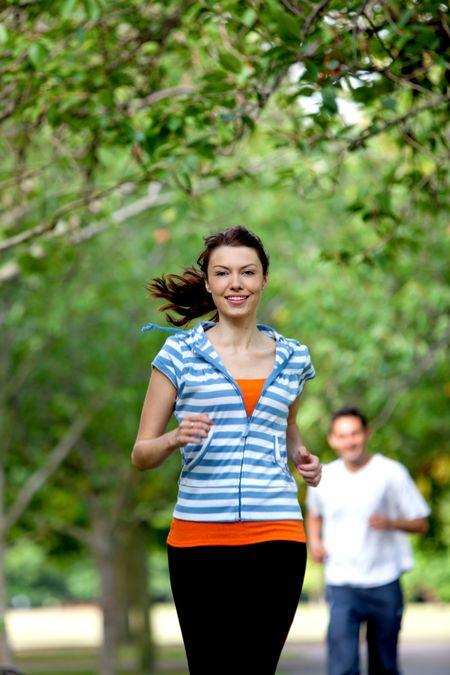 Beautiful casual girl running at the park