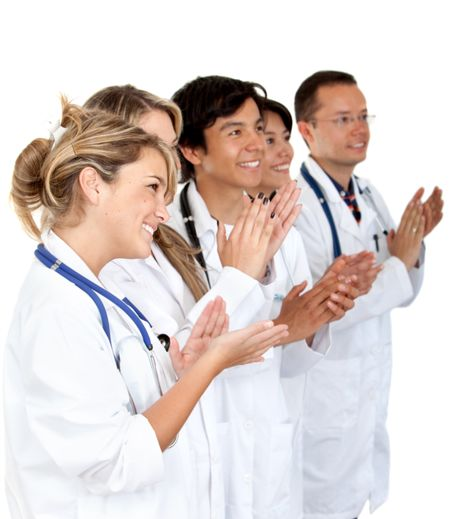 Group of doctor applauding isolated over a white background