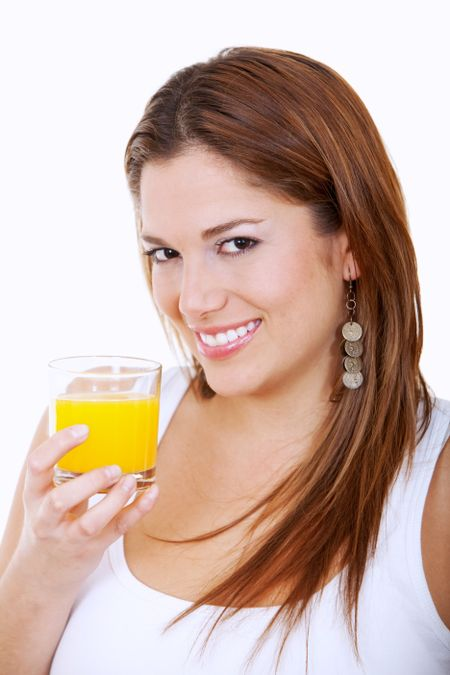 Woman drinking orange juice isolated over a white background