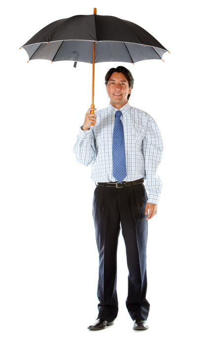 Business man under an umbrella isolated over a white background