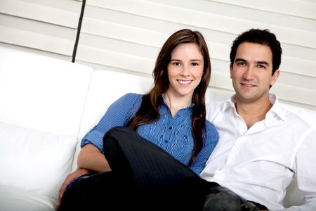 Beautiful loving couple in their living room