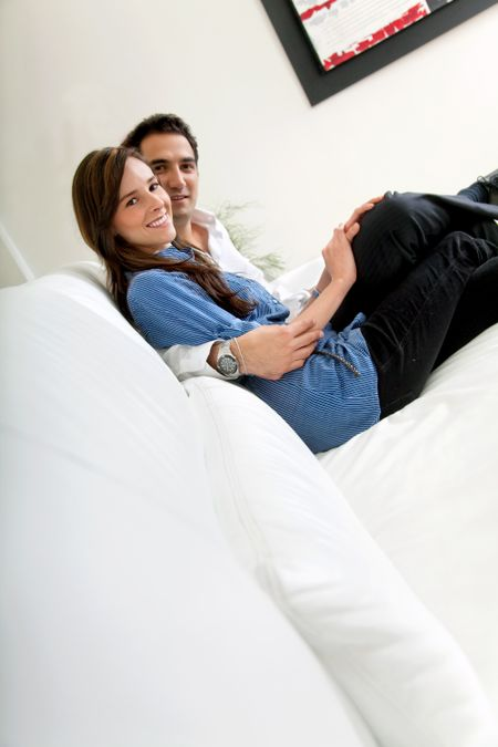 Beautiful loving couple at their living room