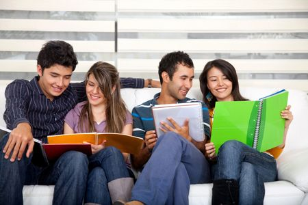 Group of young people studying at home