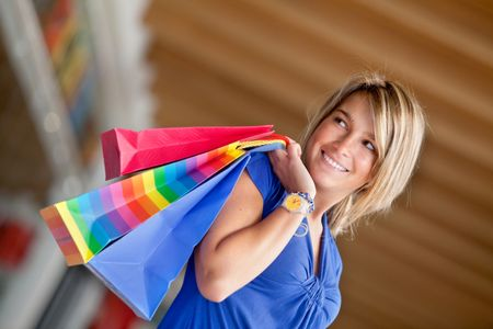 Beautiful woman at a shopping center smiling