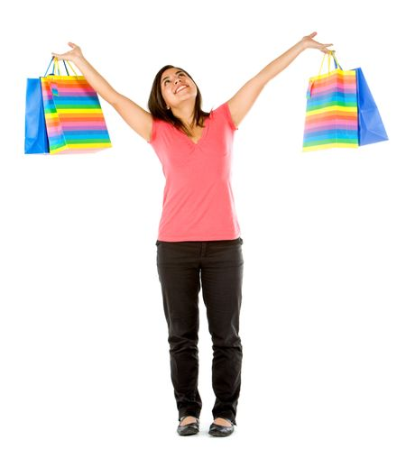 Happy shopping woman with arms open isolated on white