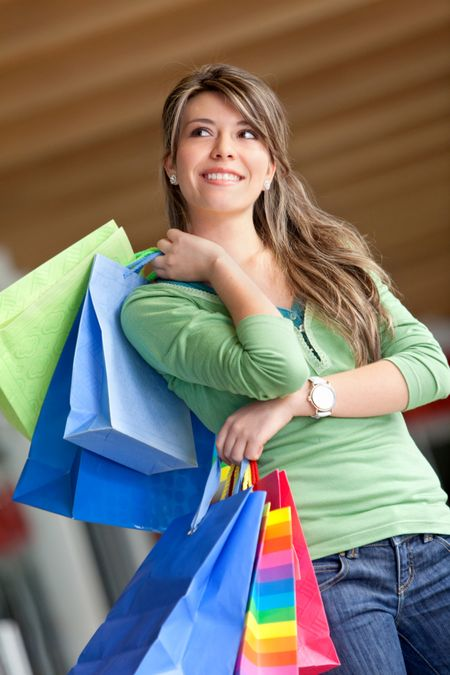 Beautiful shopping girl smiling with paper bags