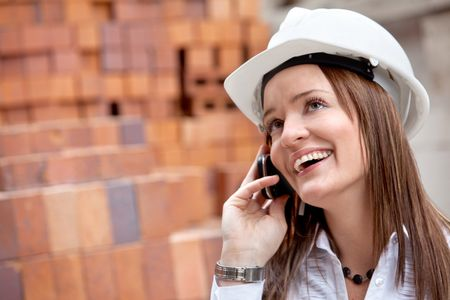 Female engineer on the phone at a construction site