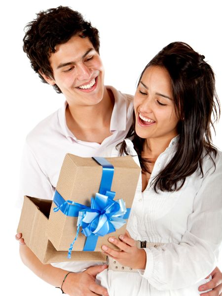 Young man giving his girlfriend a present isolated over a white background