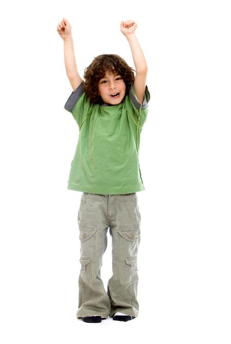 Excited little boy with arms up isolated over a white background