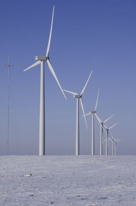 Row of wind turbines, part of windfarm in rural Illinois, in winter
