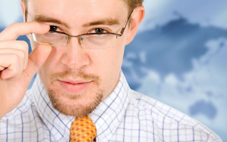 business man portrait with glasses in a corporate environment