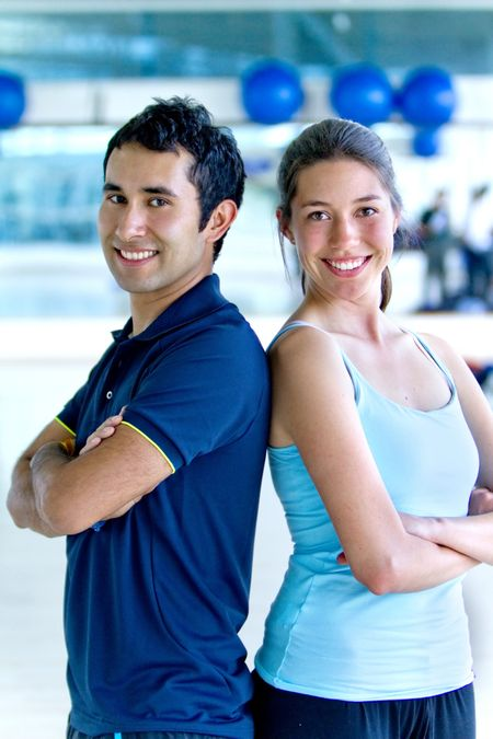 Portrait of a beautiful happy couple at the gym